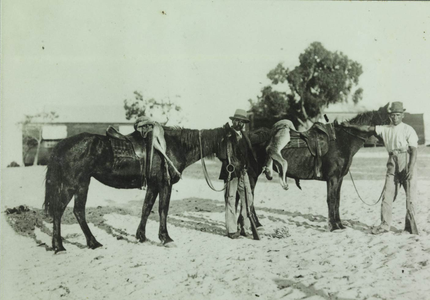 Moore River Native Settlement two horseman with kangaroos