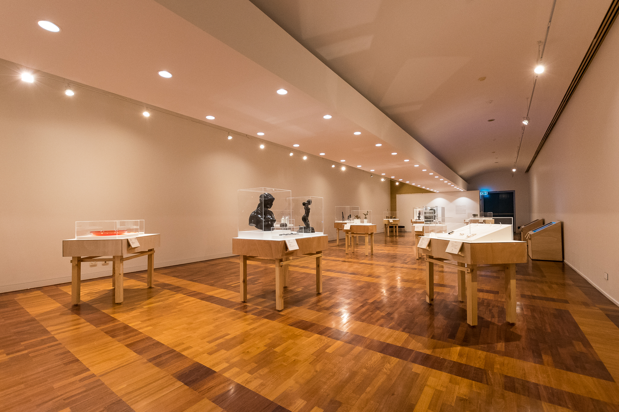 Interior of an art gallery with displays of art pieces.