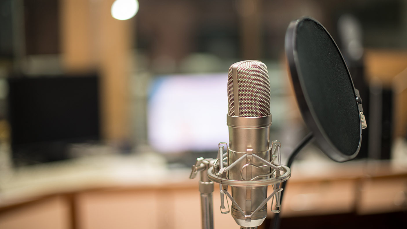 Close up photo of a microphone in a recording studio