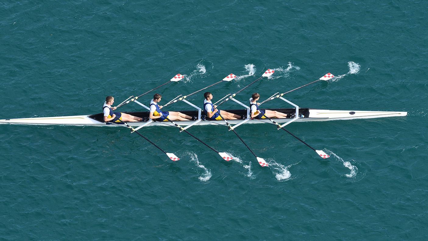 Upper view of quadruple scull rowing team during the race