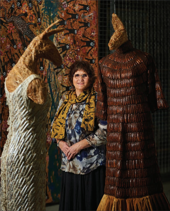 Nalda Searles standing next to two of her creations