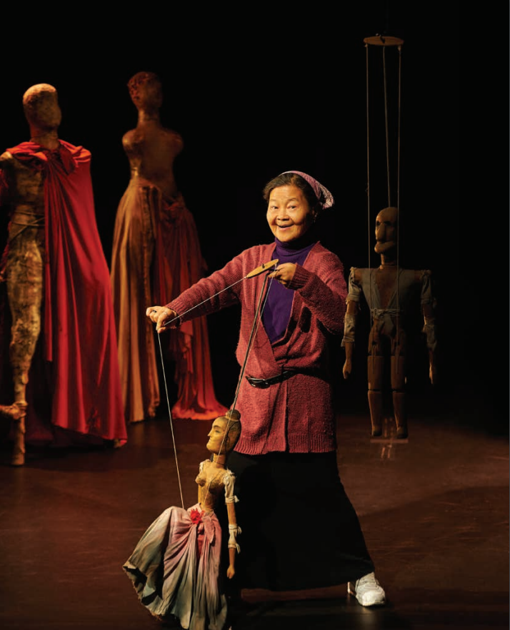 Noriko Nishimoto playing with a puppet