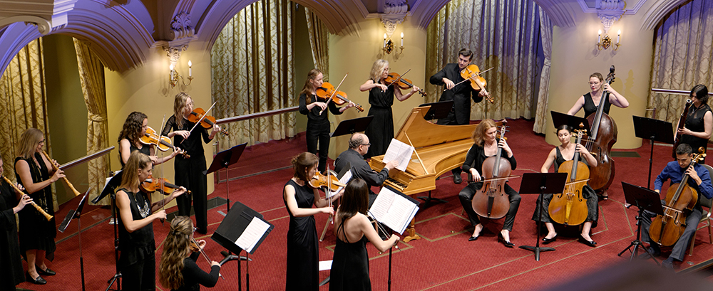 A group of classical musicians on stage