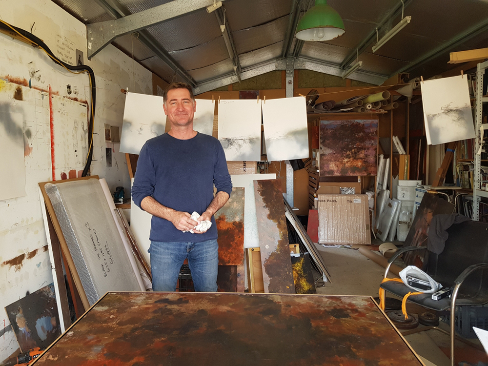 A photo of artist Merrick Belyea in his studio in Fremantle.