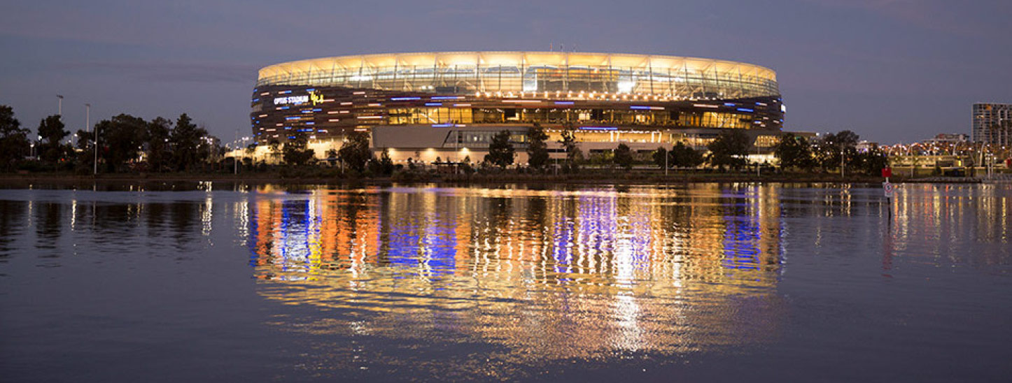 Optus Stadium view from the Swan River at twilight.