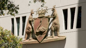 A closeup photo of the WA State Government coat of arms on Parliament House