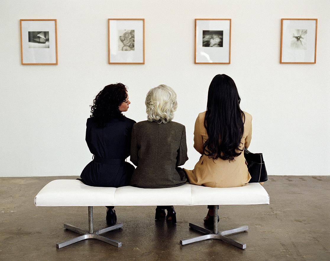 art gallery visitors looking at paintings
