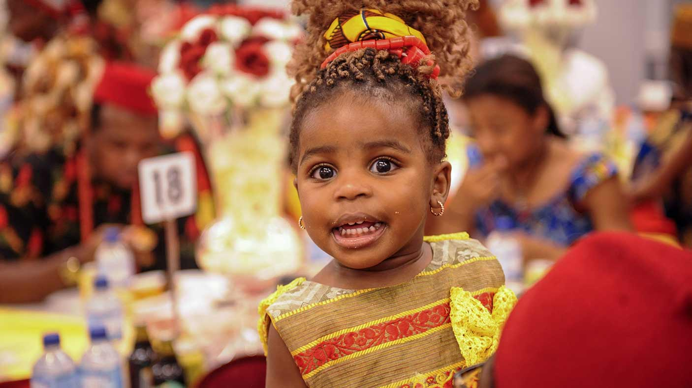 A young girl smiling at an event