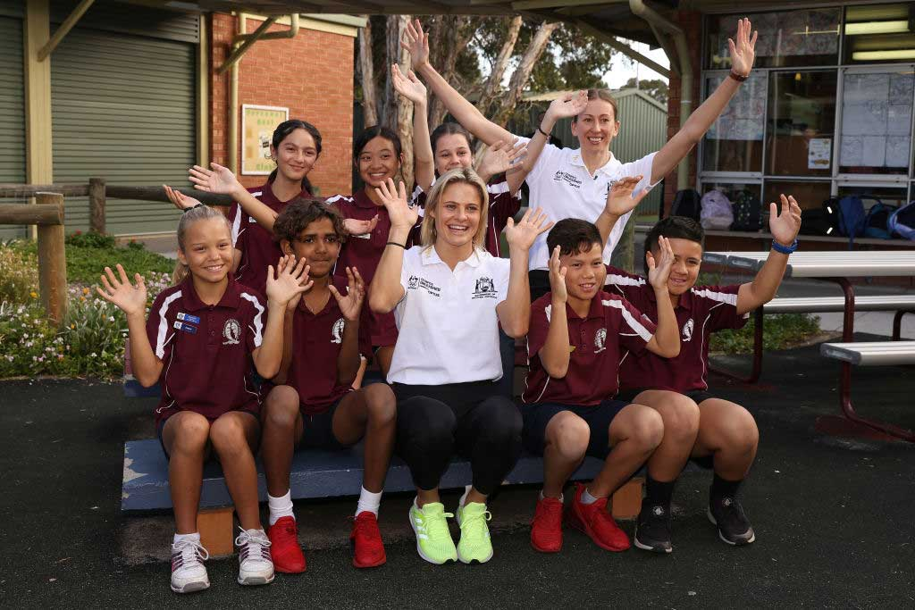 Nina Kennedy and Natalie Burton pose with students during the Olympics Unleashed Western Australia
