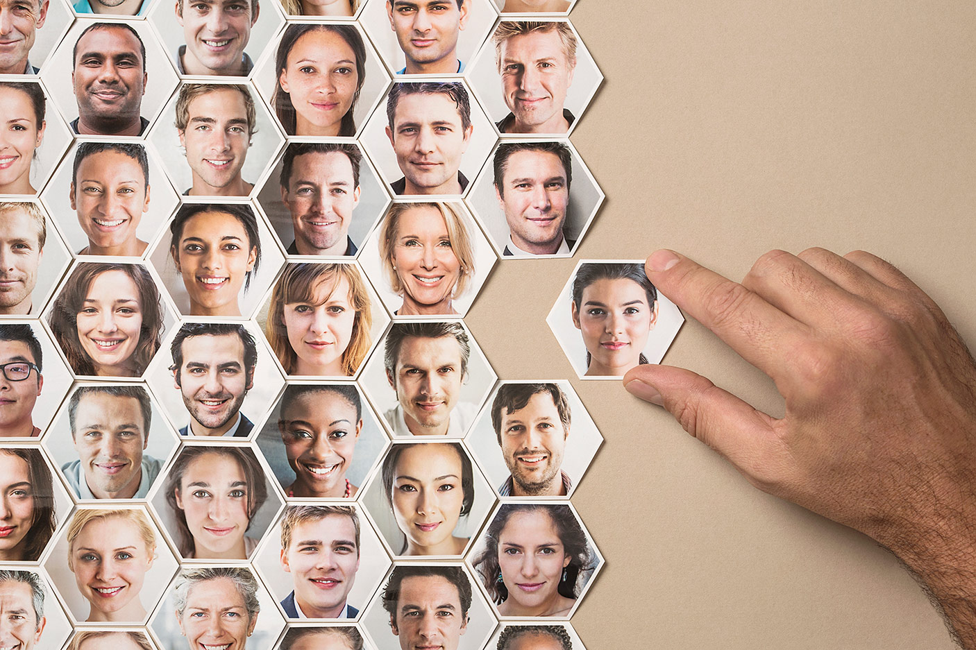 Montage of people's faces on hexagon tiles