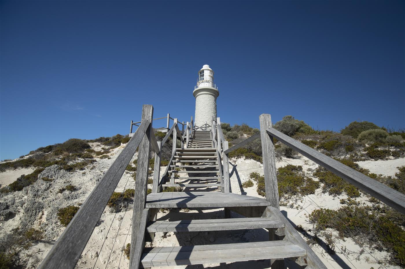 Rottnest Island Lighthouse on top of the steps from the beach.