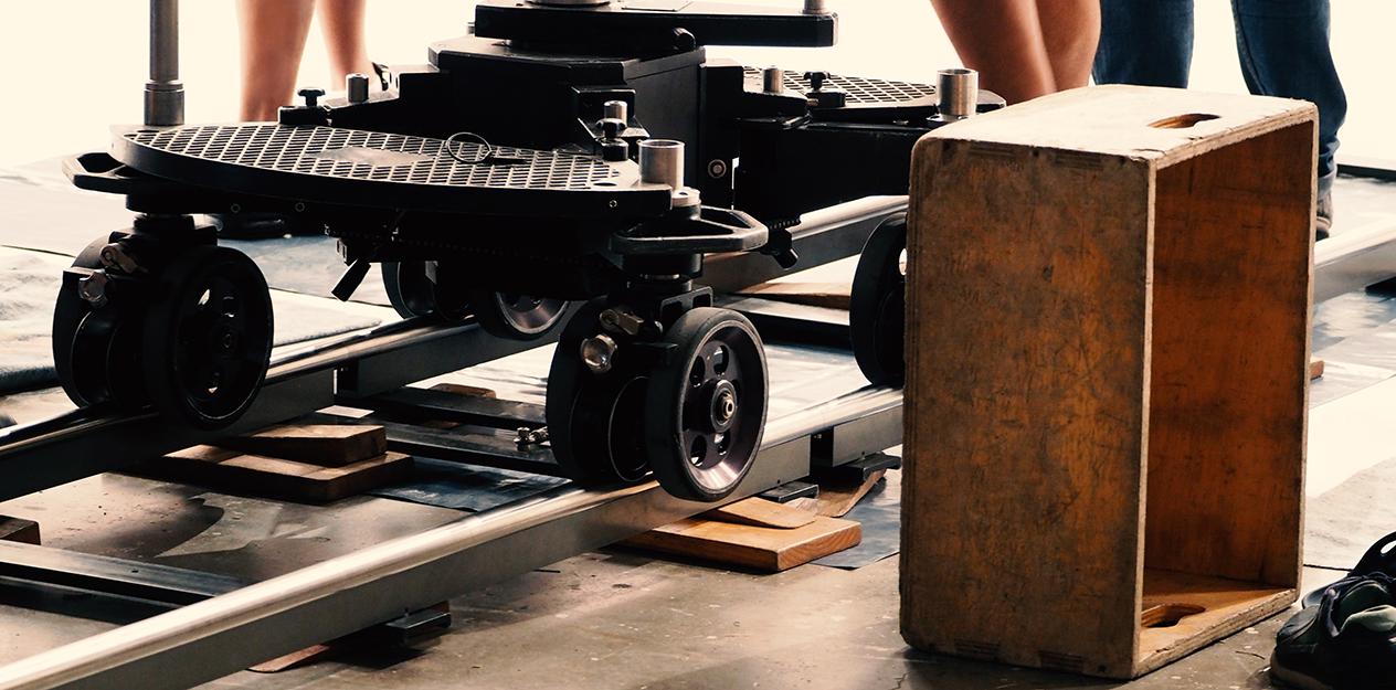 Movie camera dolly on tracks