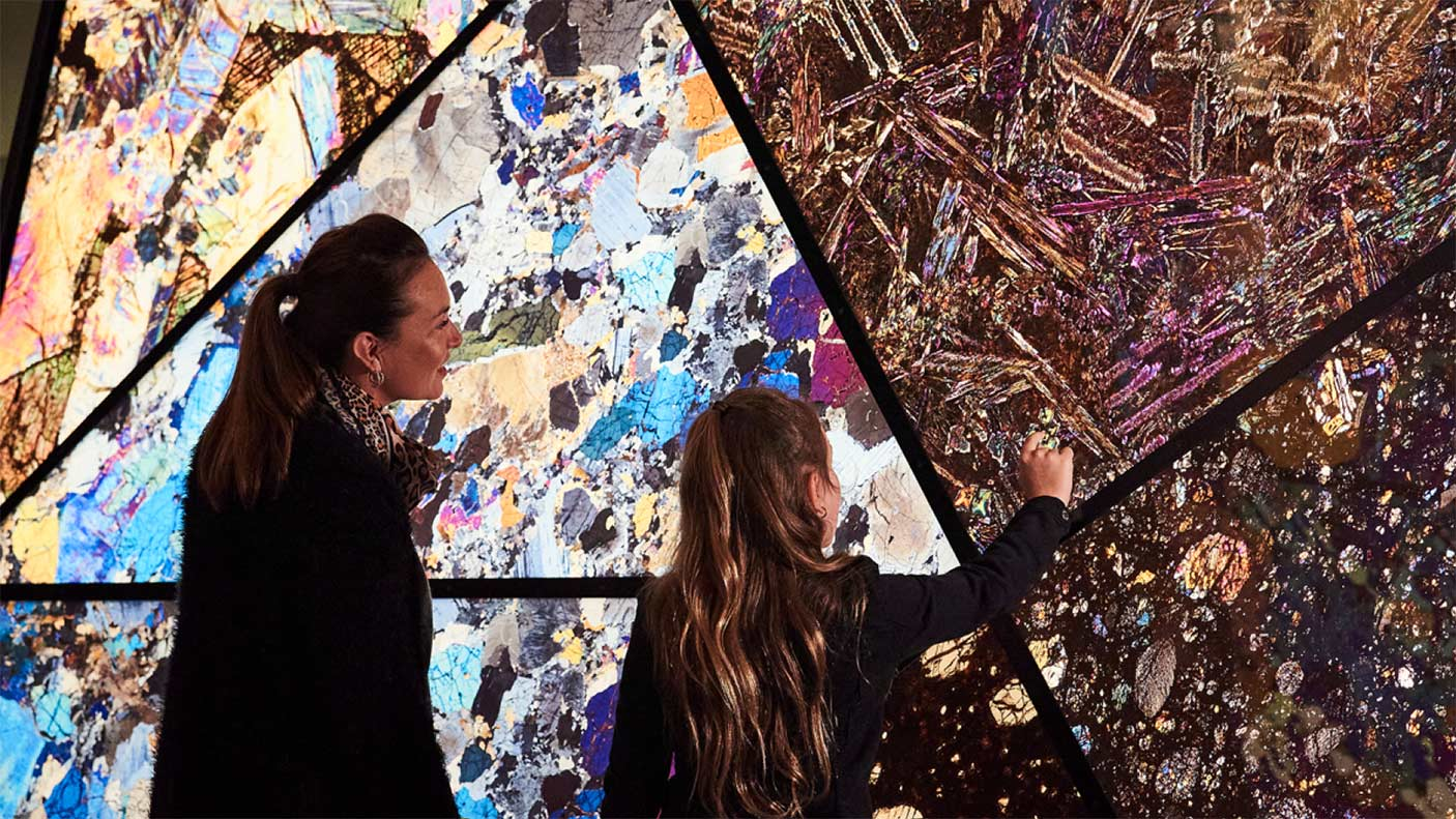 A woman and a girl looking at an exhibit at the new WA Museum Boola Bardip