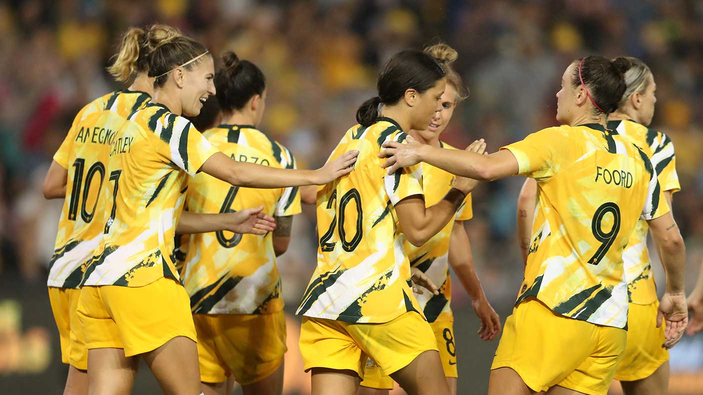 Sam Kerr of the Australian Matildas is congratulated by team mates after scoring a goal during the Women's Olympic Football Tournament Play-Off