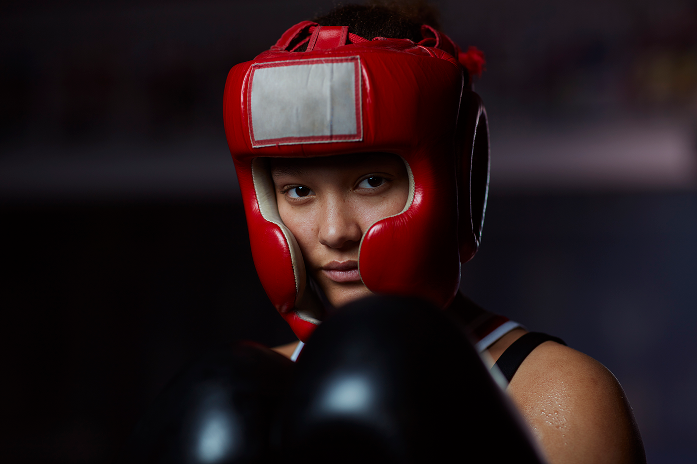 Portrait of teenage athletic boxing girl - stock photo