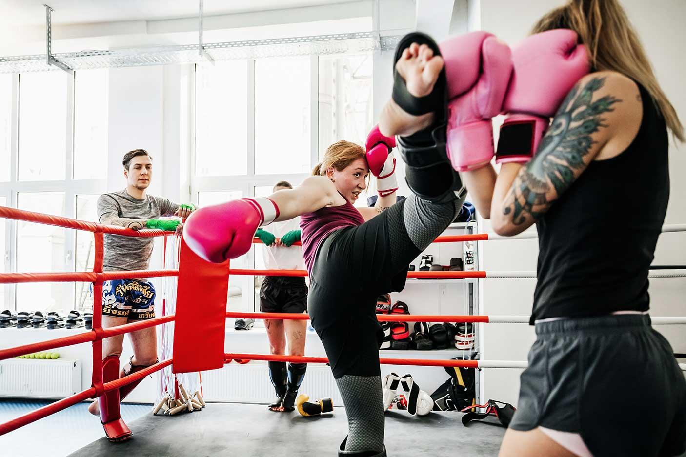 Women sparring at Thai Boxing gym