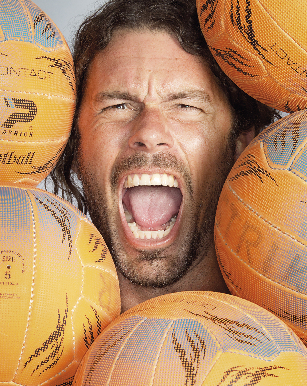 Portrait of Adam Laycock amongst netballs