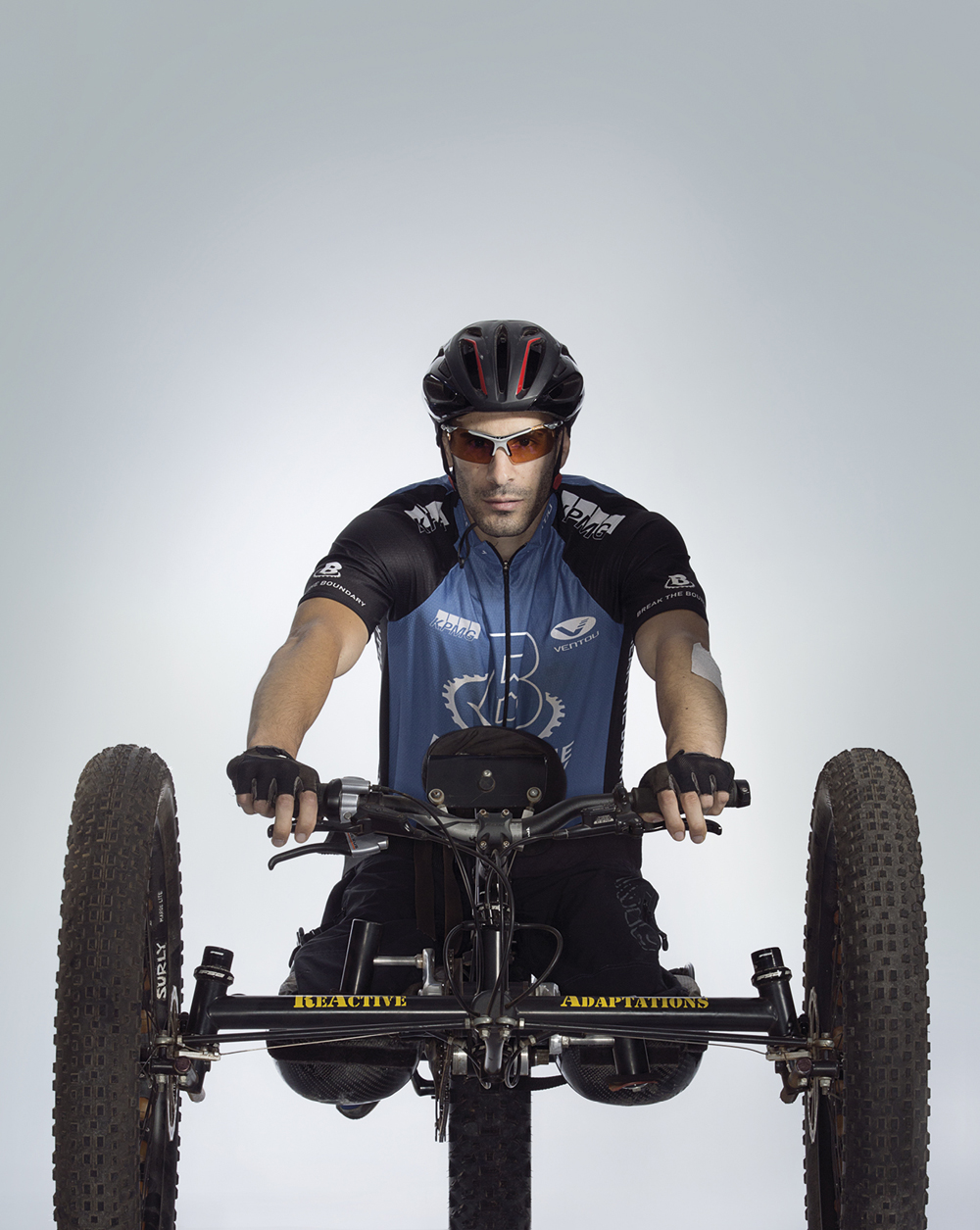 Portrait of Andrew Liddawi on a hand cycle
