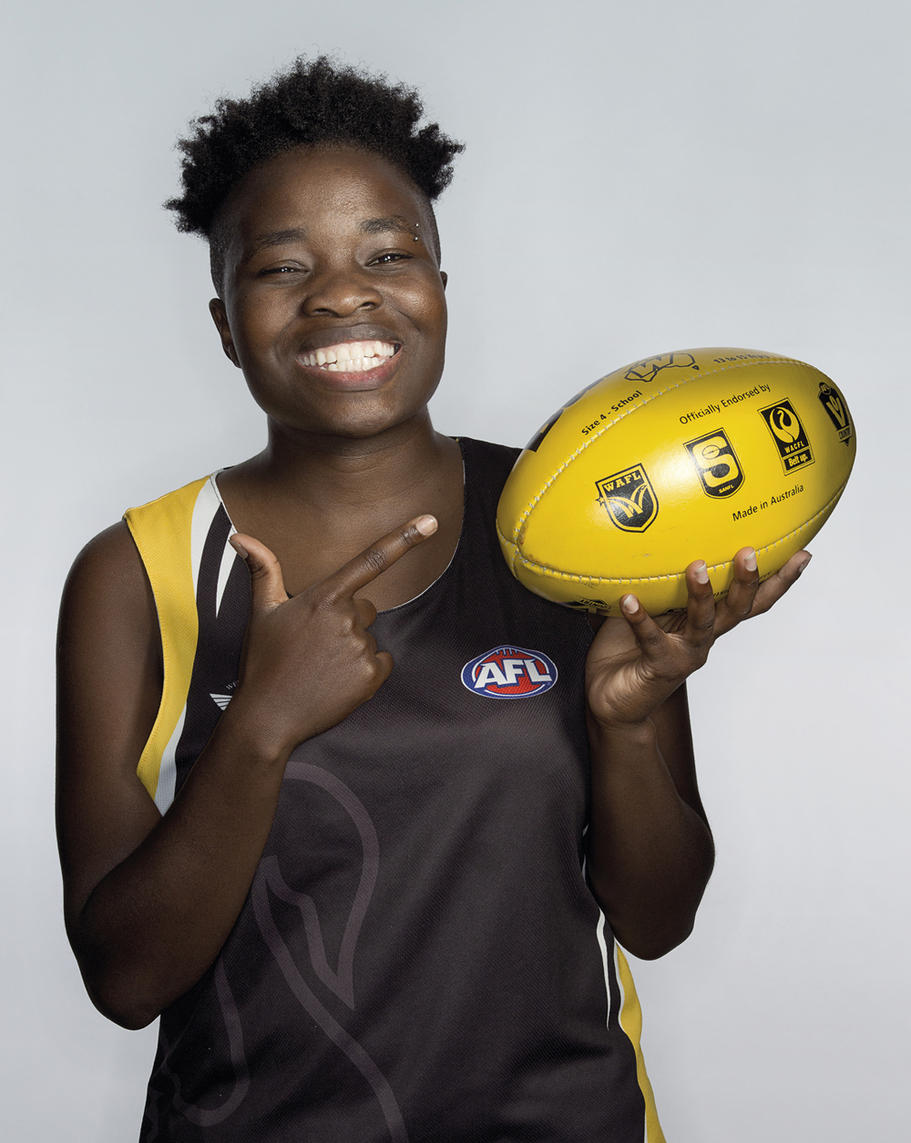 Portrait of Bella Ndayikeze with a football