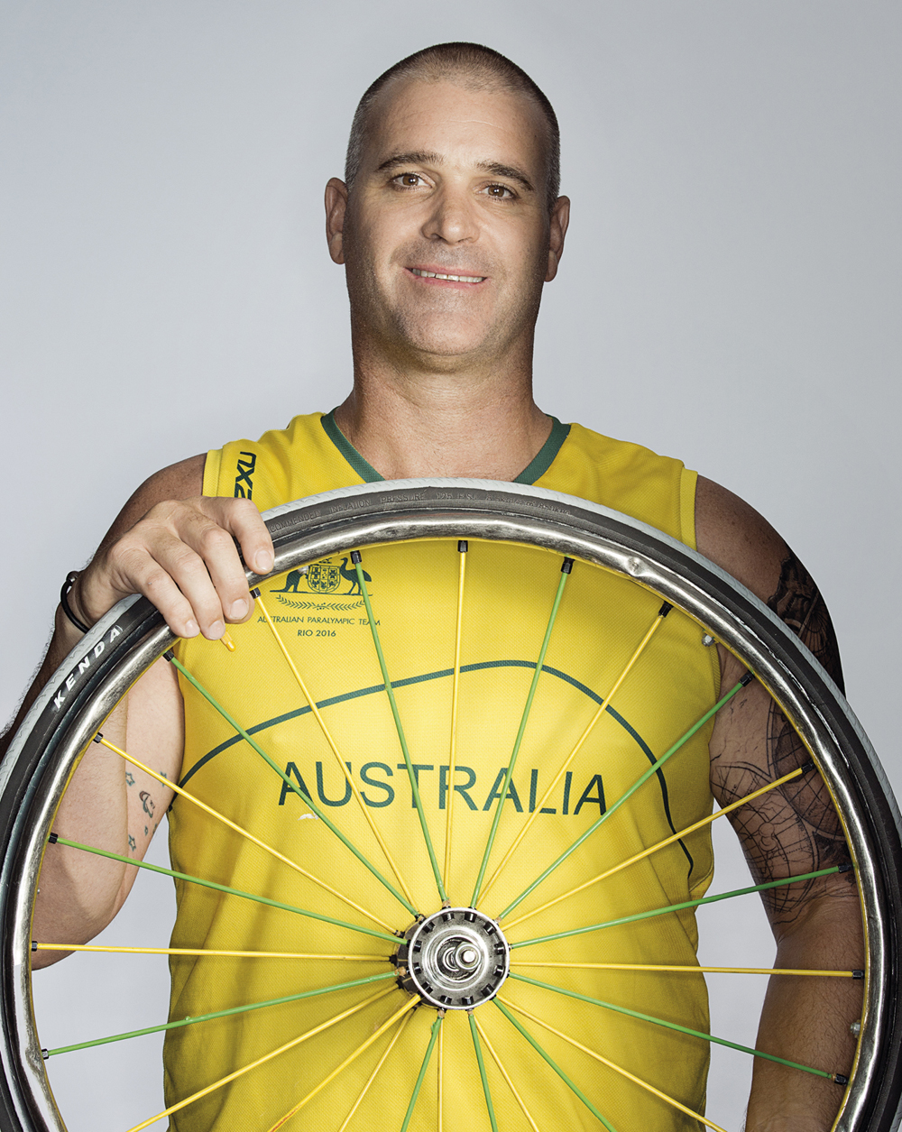 Portrait of Brad Ness holding a wheel