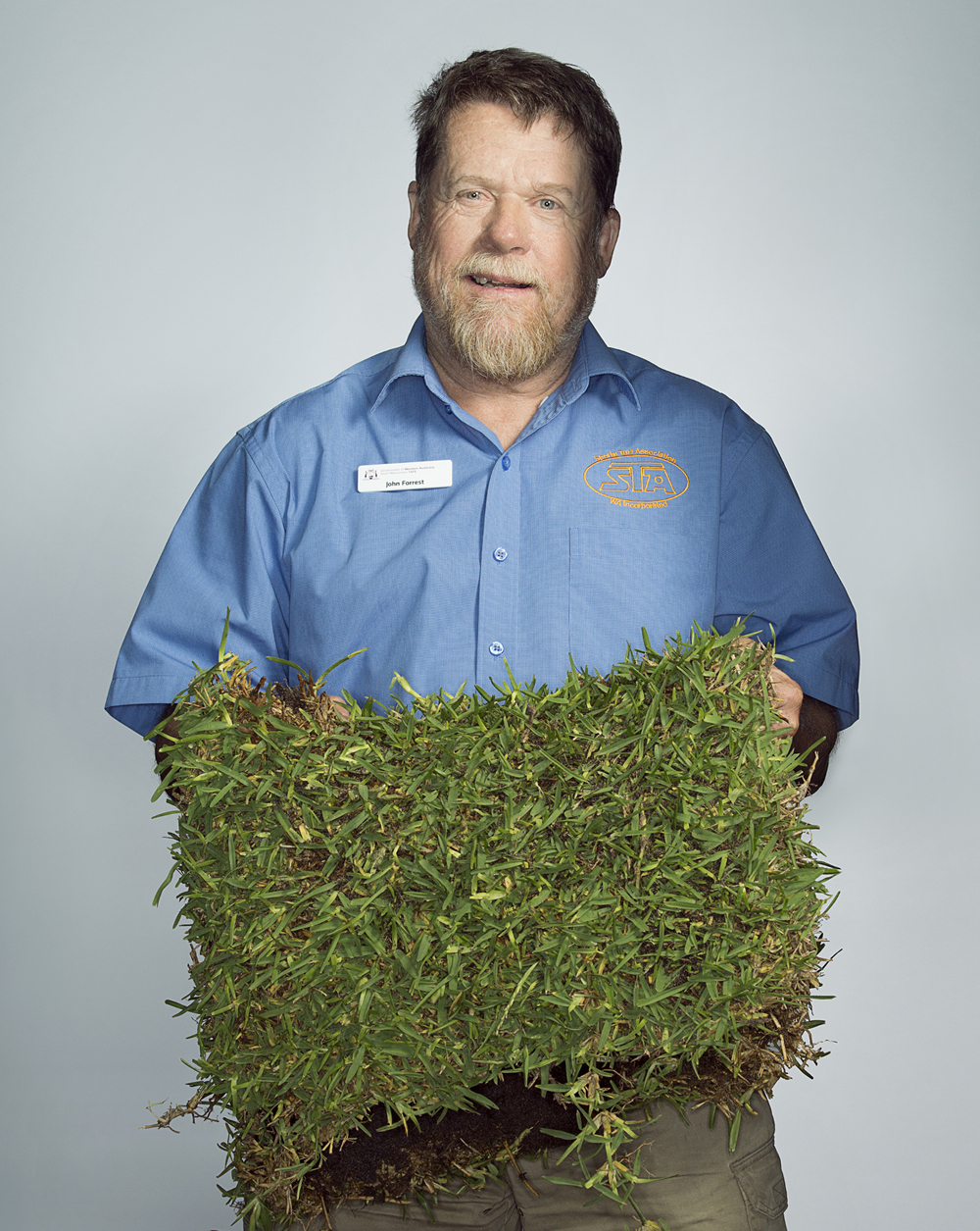 Portrait of John Forrest holding some turf