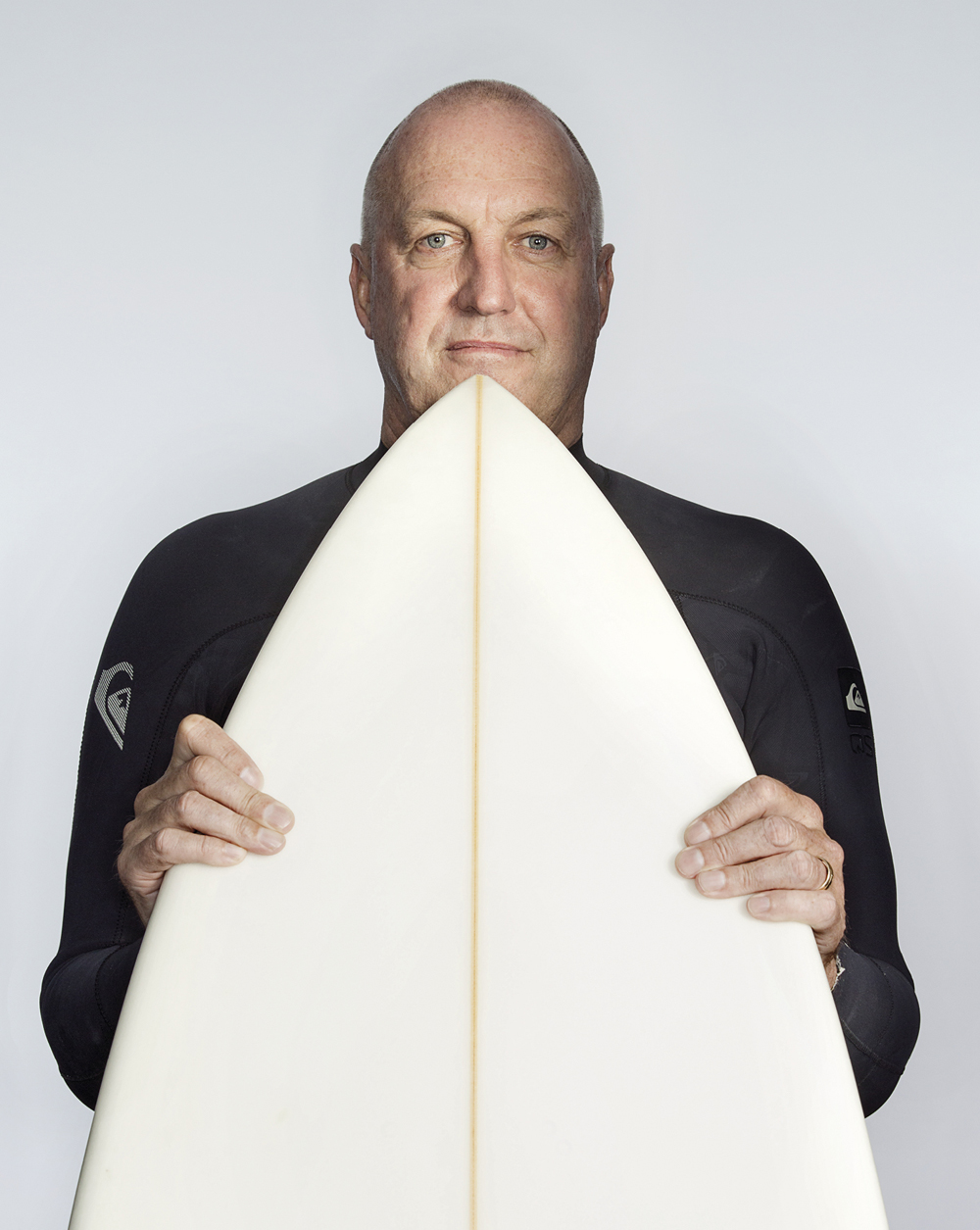 Portrait of Mark Lane with a surfboard