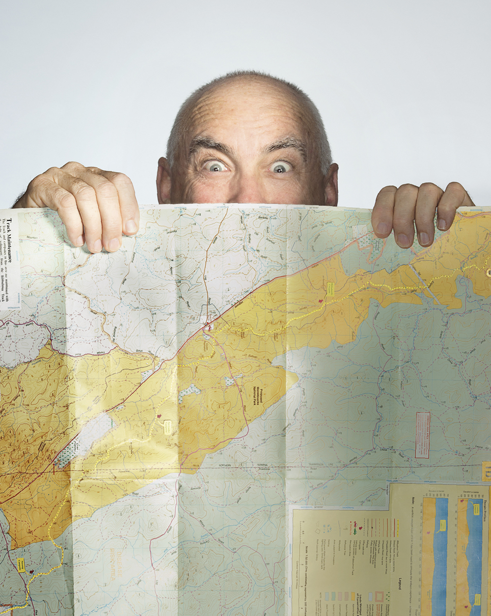 Portrait of Mike Wood behind a map
