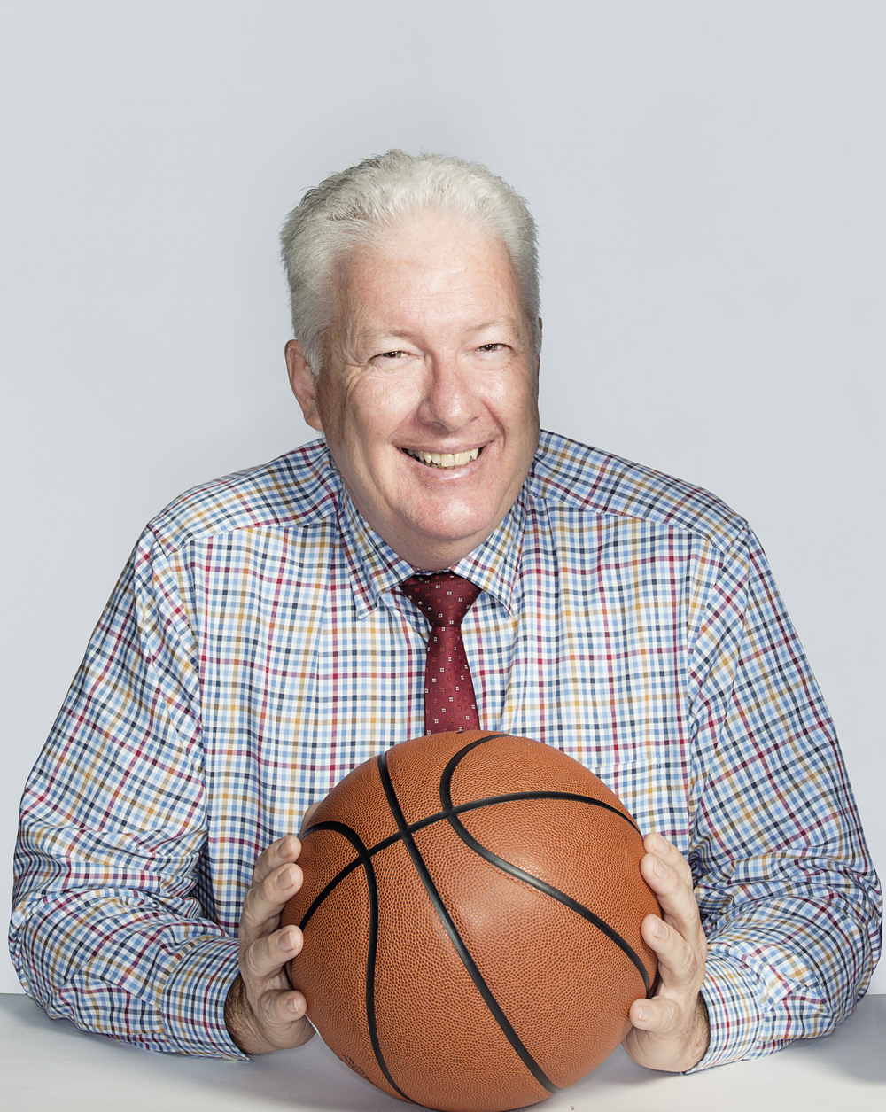 Portrait of Neil Kegie with a basketball