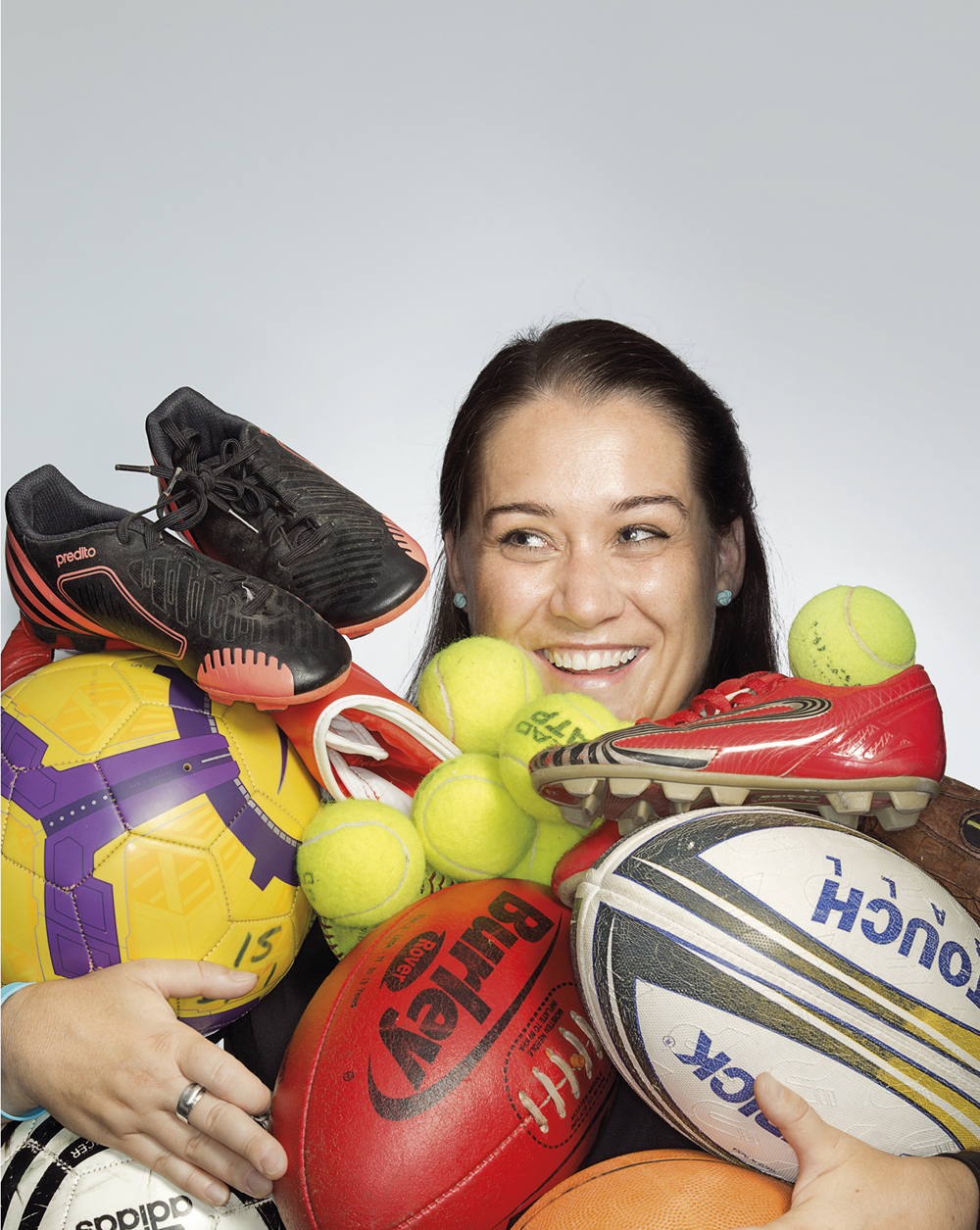 Portrait of Nicki Bardwell holding sports equipment