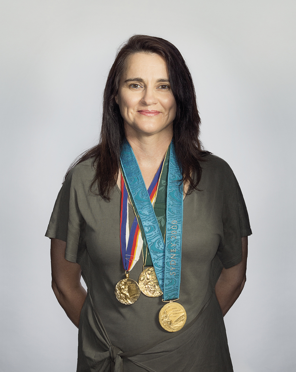 Portrait of Rechelle Hawkes with her medals